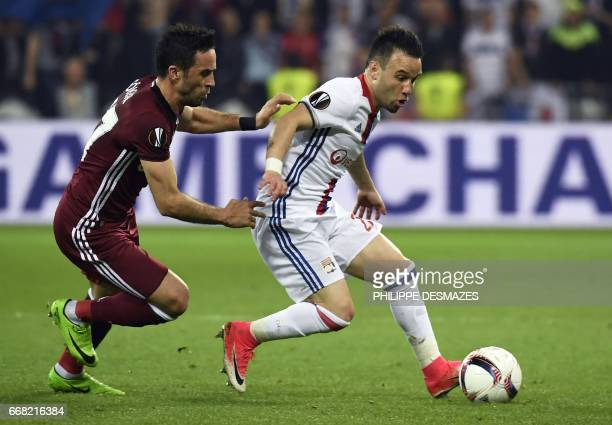 Besiktas' Turkish defender Gokhan Gonul vies with Lyon's French forward Mathieu Valbuena during the UEFA Europa League first leg quarter final...