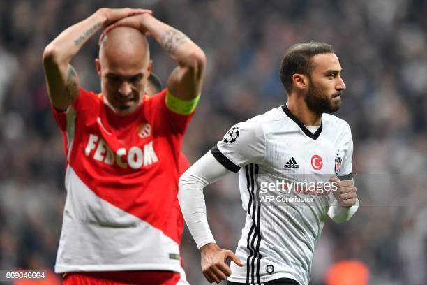 Besiktas' Turkish forward Cenk Tosun celebrates after scoring a goal next to Monaco's Italian defender Andrea Raggi during the UEFA Champions League...