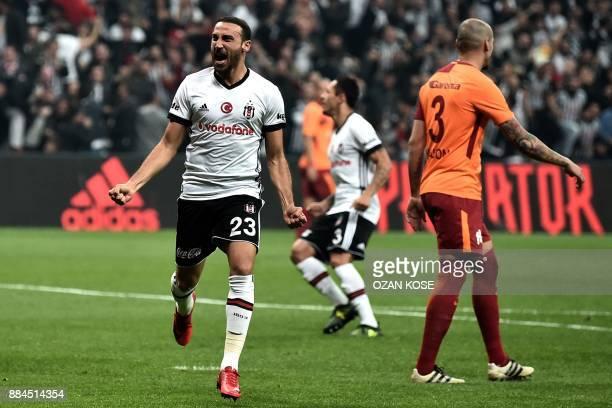 Besiktas' Turkish forward Cenk Tosun celebrates after scoring a goal during the Turkish Super Lig football match between Besiktas and Galatasaray on...