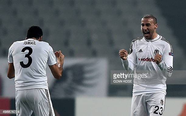 Besiktas' Turkish forward Cenk Tosun celebrates with Besiktas' Turkish defender Ismail Koybasi after scoring a goal during the UEFA Europa League...