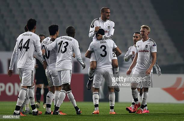 Besiktas' Turkish forward Cenk Tosun is carried by teammates after scoring a goal during the UEFA Europa League football match between Besiktas and...