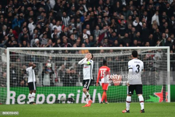 Besiktas' Turkish midfielder Oguzhan Ozyakup reacts after missing a goal opportunity during the UEFA Champions League Group G football match between...