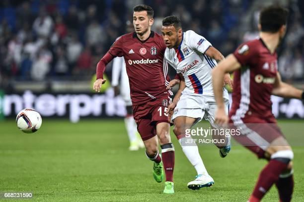 Besiktas' Turkish midfielder Oguzhan Ozyakup vies with Lyon's French midfielder Corentin Tolisso during the UEFA Europa League first leg quarter...