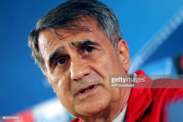 Besiktas' Turkish Senol Gunes speaks during a press conference on October 16 at the Louis II Stadium in Monaco on the eve of the UEFA Champions...