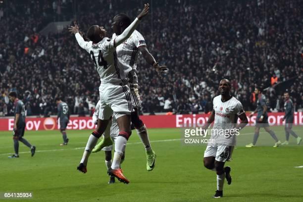 TOPSHOT Besiktas' Vincent Aboubakar celebrates with Besiktas' Portoguese midfielder Talisca after scoring a goal during their UEFA Europa League...