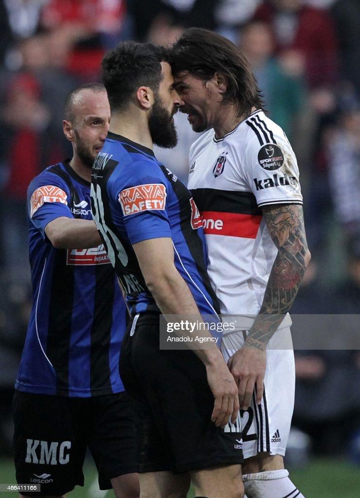 Besiktas's Adem Gulum and Caner Osmanpasa of SAI Kayseri Erciyesspor argue with each other during the Turkish Spor Toto Super League football match...