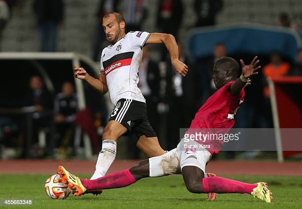 Besiktas's Cenk Tosun is in action with Khalifa Sankaré of Astreas Tripolis during their UEFA Europa League Group C match Besiktas JK v Asteras...