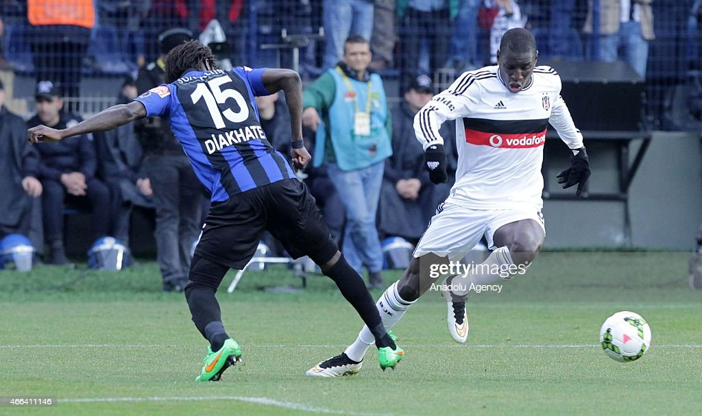Besiktas's Demba Ba in action against Papa Diakhate of SAI Kayseri Erciyesspor during the Turkish Spor Toto Super League football match between...