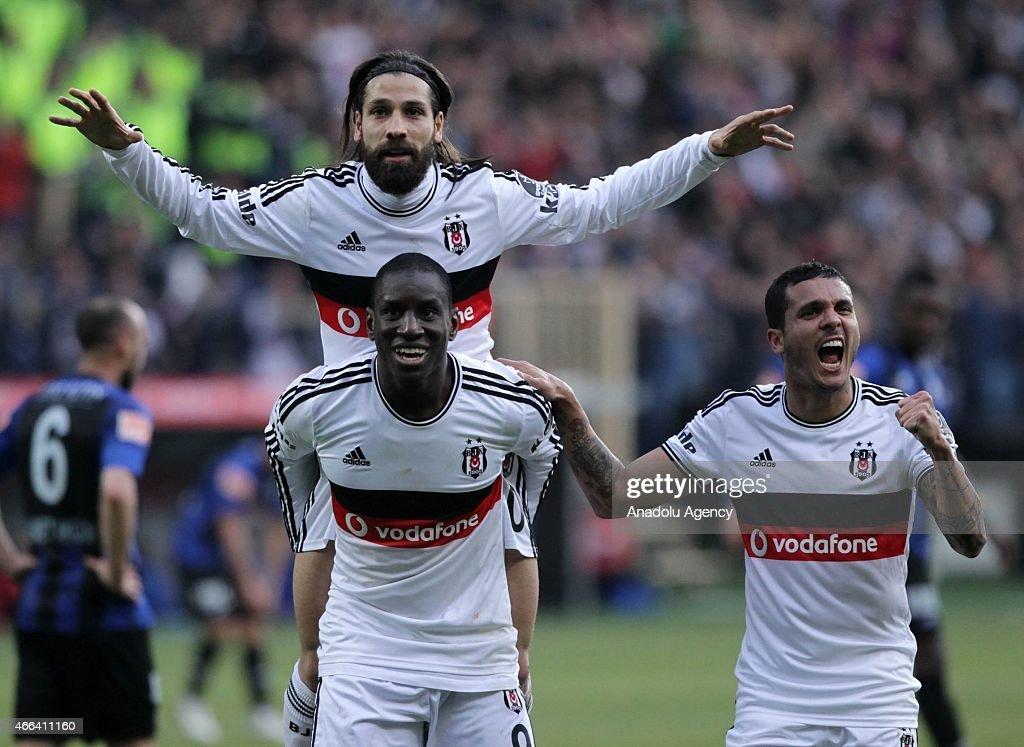 Besiktas's Demba Ba Olcay Sahan and Motta celebrate their team's score during the Turkish Spor Toto Super League football match between Besiktas and...