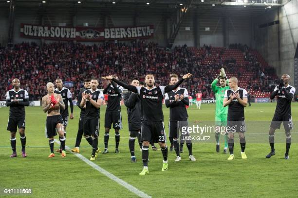 Besiktas's forward Cenk Tosun and his teammates react after winning the UEFA Europa League football match Hapoel Beersheba vs Besiktas on February 16...
