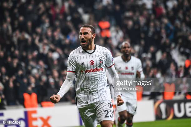 Besiktas's forward Cenk Tosun celebrates scoring during the UEFA Europa League football match Besiktas vs Hapoel Beersheba on February 23 2017 at the...