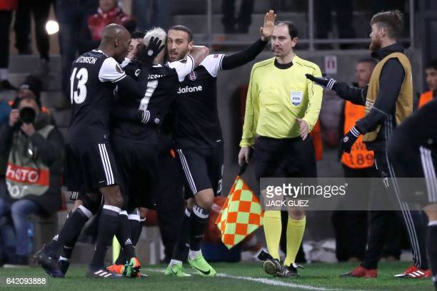 Besiktas's forward Cenk Tosun celebrates with teammates after scoring a goal during the UEFA Europa League football match Hapoel Beersheba vs...