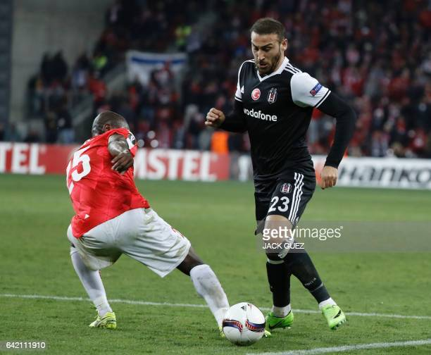 Besiktas's forward Cenk Tosun dribbles Hapoel Beersheba's Brazilian defender William Soares during the UEFA Europa League football match Hapoel...