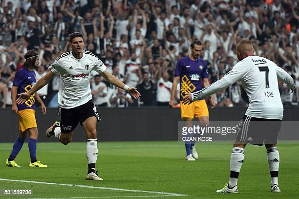 Besiktas's German forward Mario Gomez celebrates with his team mates after scoring a goal during the Turkish Spor Toto Super league football match...
