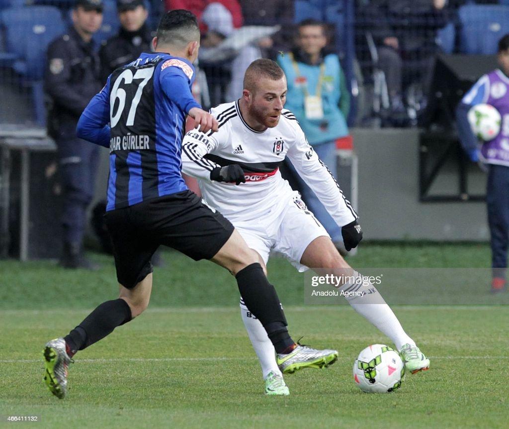 Besiktas's Gokhan Tore in action against Serdar Gurler of SAI Kayseri Erciyesspor during the Turkish Spor Toto Super League football match between...
