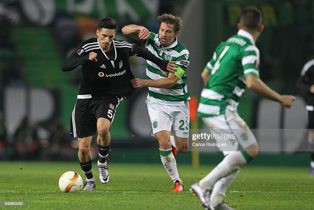 Besiktas's midfielder Jose Sosa vies with Sporting's midfielder Adrien Silva during the match between Sporting CP and Besiktas JK for UEFA Europe...