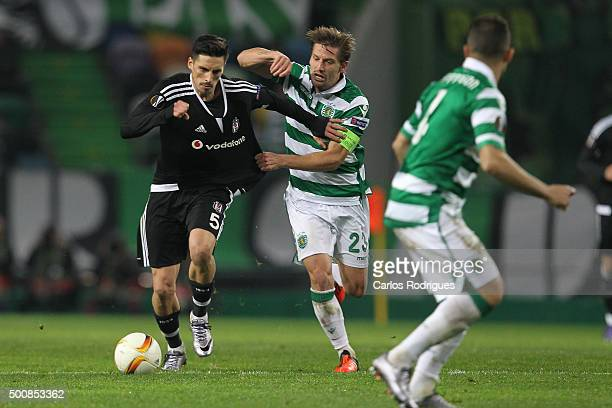 Besiktas's midfielder Jose Sosa vies with Sporting's midfielder Adrien Silva during the match between Sporting CP and Besiktas JK for UEFA Europe...
