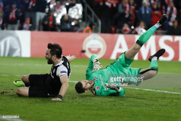 Besiktas's Spanish goalkeeper Fabri falls during the UEFA Europa League football match Hapoel Beersheba vs Besiktas on February 16 2017 at Turner...
