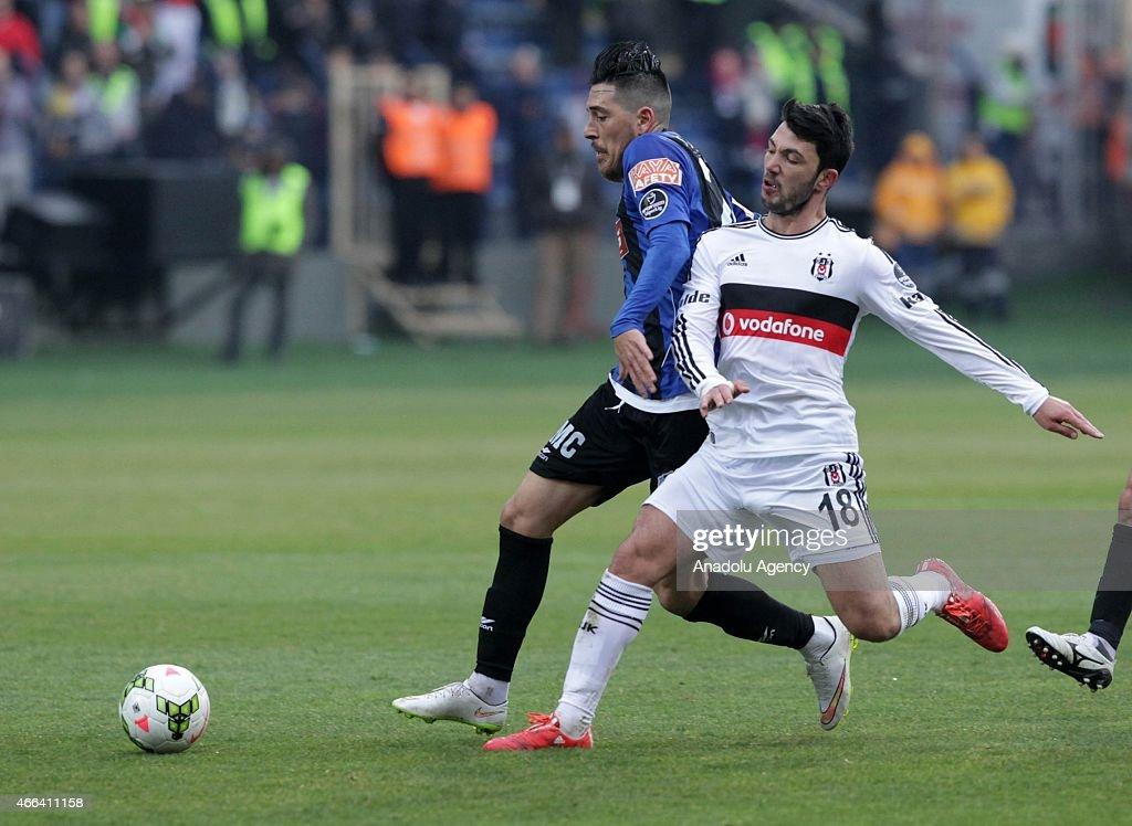 Besiktas's Tolgay Arslan in action against Yasin Pehlivan of SAI Kayseri Erciyesspor during the Turkish Spor Toto Super League football match between...
