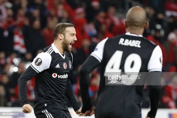 Besiktas's Turkish forward Cenk Tosum celebrates after scoring a goal during the UEFA Europa League football match Hapoel Beersheba vs Besiktas on...