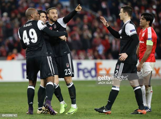 Besiktas's Turkish forward Cenk Tosum celebrates with teammates after scoring a goal during the UEFA Europa League football match Hapoel Beersheba vs...