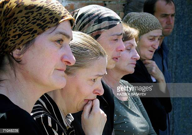 Relatives of killed students cry in the destroyed school's gymnasium where 331 people died in the hostage siege in Beslan during 'All Russia the last...