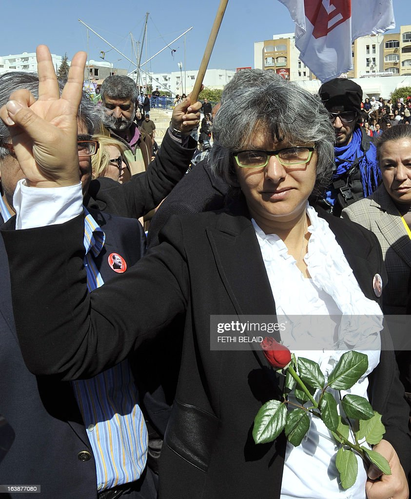 Besma Khalfaoui, the widow of slain Tunisian opposition leader Chokri Belaid, makes the victory sign as she joins Tunisians marking 40 days since the killing of her husband in Tunis on March 17, 2013. Belaid, a critic of the ruling Islamists whose death plunged Tunisia into turmoil, was gunned down outside his home on February 6 in a killing blamed by the authorities on radical Islamists, denying any involvement. Several arrests in the case have been made, but the suspected killer remains at large.