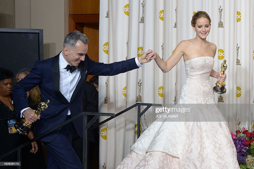 Best Actor Daniel Day-Lewis arrives in the peress room with Best Actress Jennifer Lawrence, Best Supporting Actress Anne Hathaway, and Best Supporting Actor Christoph Waltz during the 85th Academy Awards on February 24, 2013 in Hollywood, California. AFP PHOTO / Joe KLAMAR