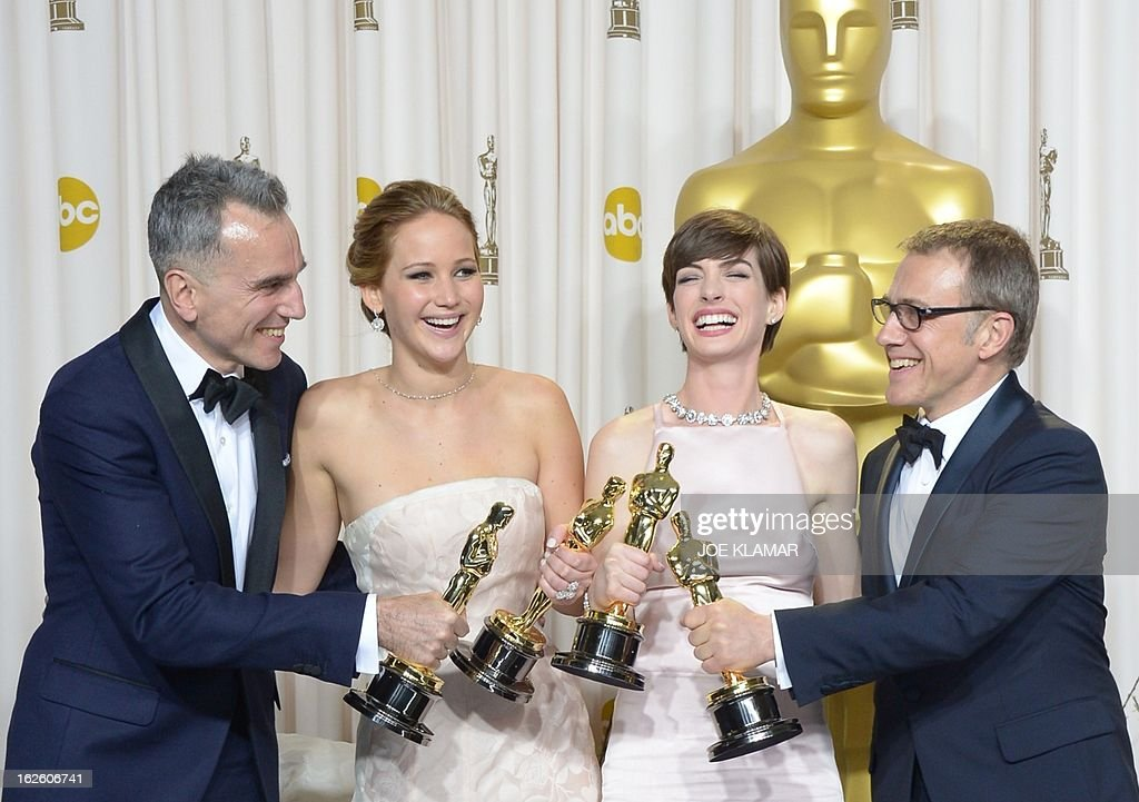 Best Actor Daniel Day-Lewis stands with Best Actress Jennifer Lawrence, Best Supporting Actress Anne Hathaway, and Best Supporting Actor Christoph Waltz during the 85th Academy Awards on February 24, 2013 in Hollywood, California. AFP PHOTO / Joe KLAMAR