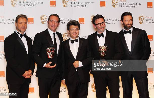 Best Actor Jean Dujardin Thomas Langmann and Michel Hazanavicius from the film 'The Artist' pose with their awards and Russell Crowe and Hugh Jackman...