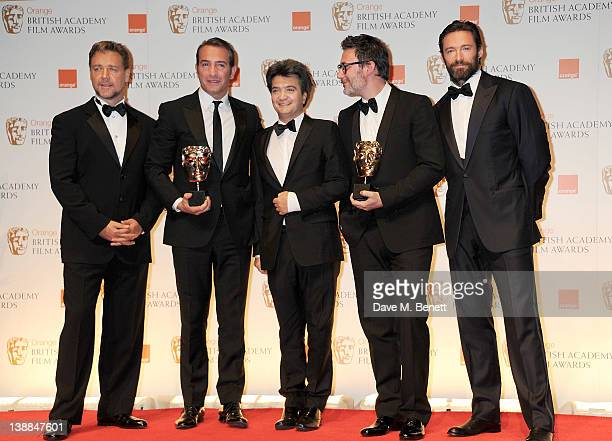 Best Actor Jean Dujardin Tomas Langmann Michel Hazanavicius of The Artist pose with presenters Russell Crowe and Hugh Jackman in the press room at...