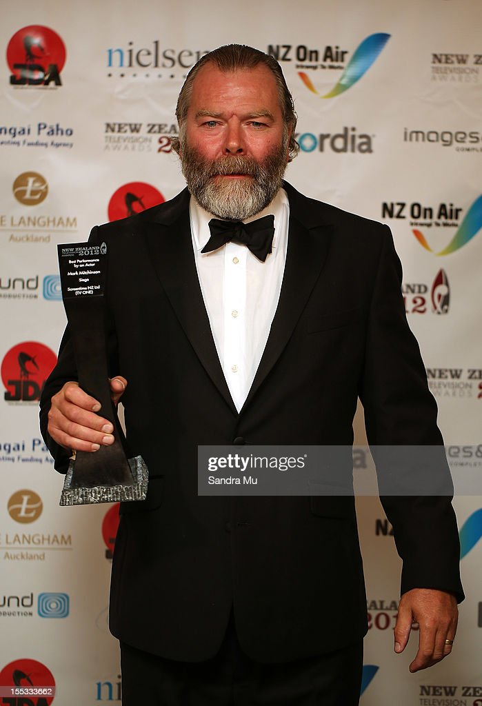 Best Actor Mark Mitchinson poses with his award during the New Zealand Television Awards at the Langham Hotel on November 3, 2012 in Auckland, New Zealand.