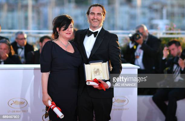 Best Actor US actor Joaquin Phoenix and Best Screenplay colaureate British director Lynne Ramsay pose on May 28 2017 during a photocall at the 70th...