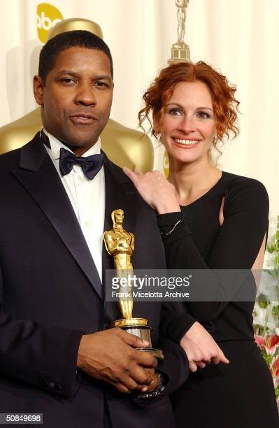 Best Actor winner Denzel Washington and Actress Julia Roberts backstage at the 74th Annual Academy Awards held at the Kodak Theatre in Hollywood Ca...