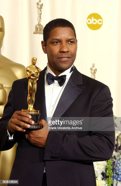 Best Actor winner Denzel Washington holds his Oscar statuete backstage at the 74th Annual Academy Awards held at the Kodak Theatre in Hollywood Ca...
