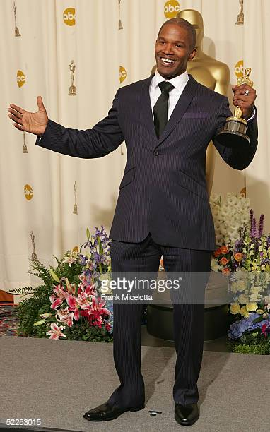 TELECAST*** Best Actor Winner Jamie Foxx poses backstage after winning an Oscar award for best actor in 'Ray' during the 77th Annual Academy Awards...
