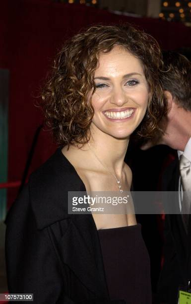Best Actress in a Drama nominee Amy Brenneman wearing a threestone diamond necklace by Roberto Coin arrives for the 53rd Annual Primetime Emmy Awards