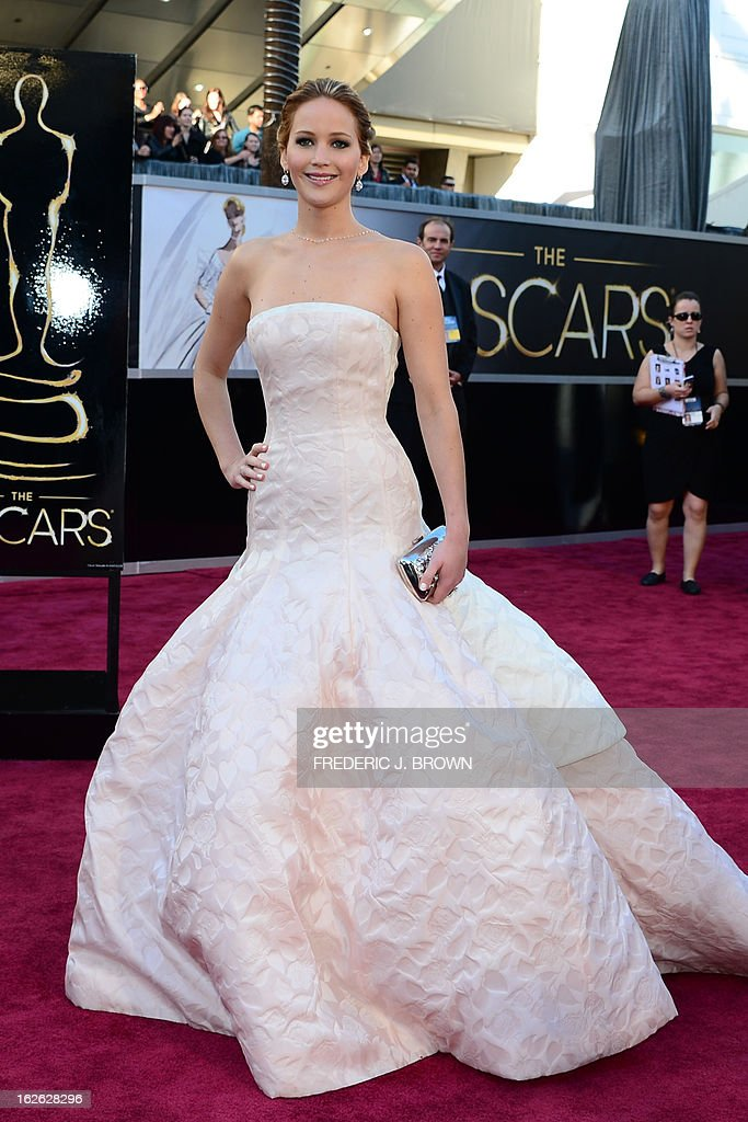 Best Actress nominee Jennifer Lawrence arrives on the red carpet for the 85th Annual Academy Awards on February 24, 2013 in Hollywood, California.