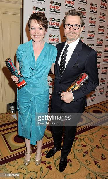 Best Actress Olivia Colman and Best Actor Gary Oldman pose in the press room at the Jameson Empire Awards at Grosvenor House on March 25 2012 in...