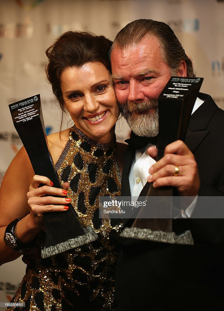 Best Actress Sara Wiseman (L) and Best Actor Mark Mitchinson pose with their awards during the New Zealand Television Awards at the Langham Hotel on November 3, 2012 in Auckland, New Zealand.