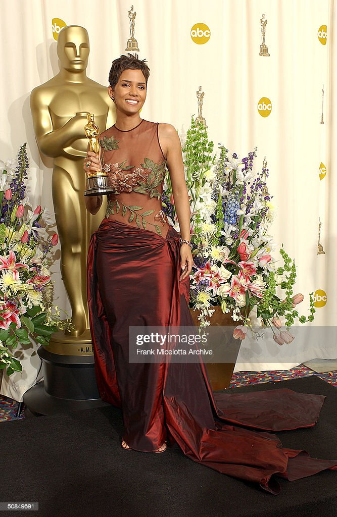 Best Actress winner <a gi-track='captionPersonalityLinkClicked' href=/galleries/search?phrase=Halle+Berry&family=editorial&specificpeople=201726 ng-click='$event.stopPropagation()'>Halle Berry</a> holds her Oscar statuete backstage at the 74th Annual Academy Awards held at the Kodak Theatre in Hollywood, Ca., March 24, 2002.