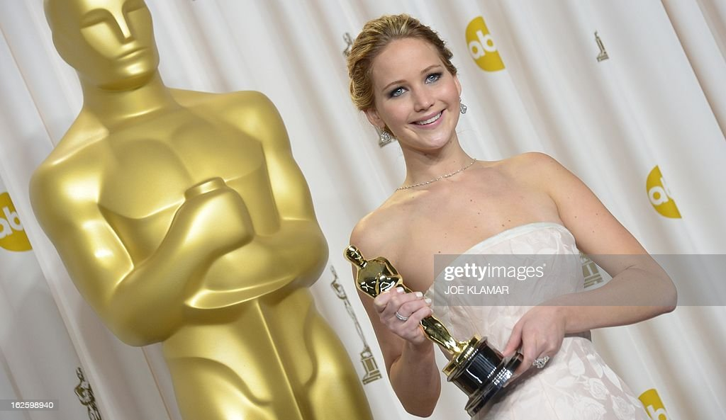 Best Actress winner Jennifer Lawrence celebrates in the press room for her role in 'Silver Linings Playbook' during the 85 Academy Awards on February 24, 2013 in Hollywood, California. AFP PHOTO / Joe KLAMAR