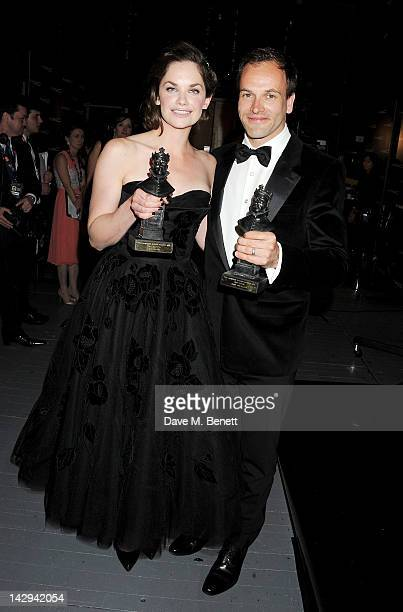Best Actress winner Ruth Wilson and Best Actor winner Jonny Lee Miller pose in the press room at the 2012 Olivier Awards held at The Royal Opera...