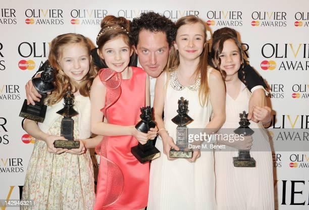 Best Actress winners Sophia Kiely Eleanor Worthington Cox Best Actor Bertie Carvel Kerry Ingram and Cleo Demetriou of Matilda The Musical pose in the...
