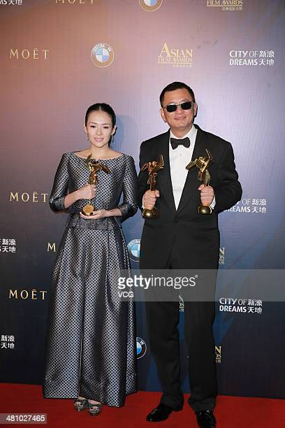 Best actress Zhang Ziyi and Best director Kar Wai Wong pose during the 8th Asia Film Award on March 27 2014 in Macau China
