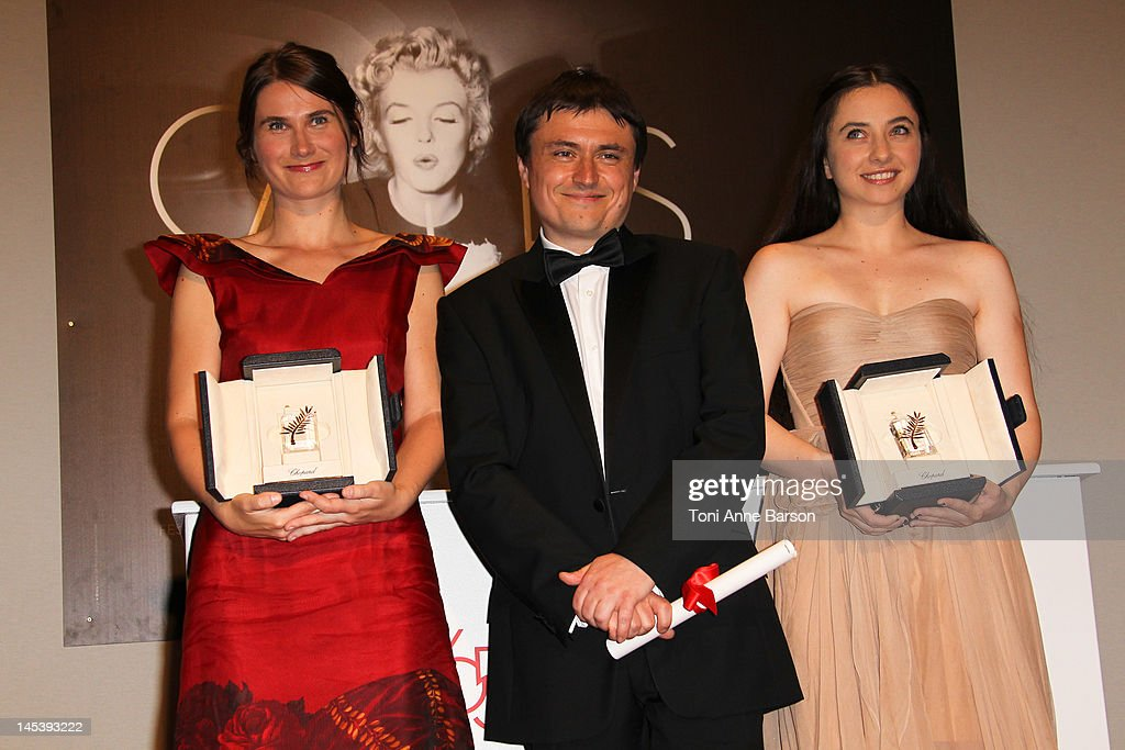 Best Actresses Cosmina Stratan (L) and Cristina Flutur (R) of 'Beyond The Hills' by Cristian Mungiu (C) poses at the Winners Photocall at Palais des Festivals on May 27, 2012 in Cannes, France.