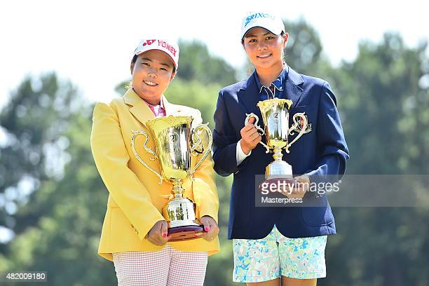 Best Amateur player Hina Arakaki of Japan and SunJu Ahn of South Korea pose with their trophies after the Century 21 Ladies Golf Tournament 2015 at...