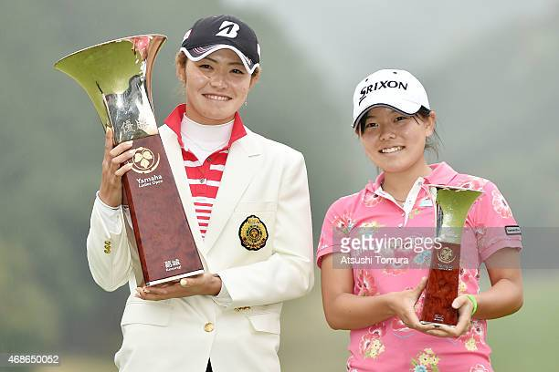 Best Amateur player Minami Katsu and Ayaka Watanabe of Japan pose with their trophies after the YAMAHA Ladies Open Katsuragi at the Katsuragi Golf...