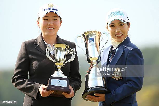 Best Amature player Hinako Yamauchi and Ritsuko Ryu of Japan pose with their trophies after the AXA Ladies Golf Tournament at the UMK Country Club on...