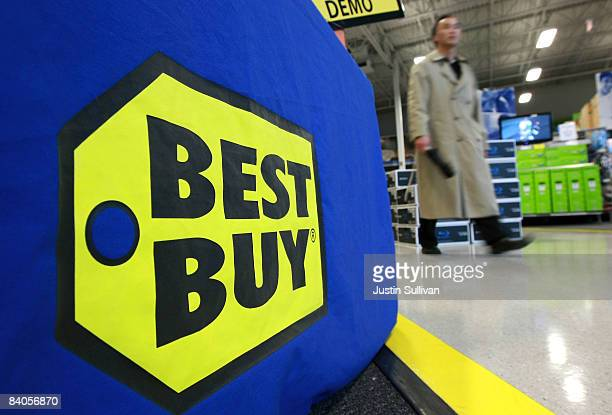 Best Buy customer walks by a sign at a Best Buy store December 16 2008 in San Francisco California As consumer spending continues to slump Best Buy...